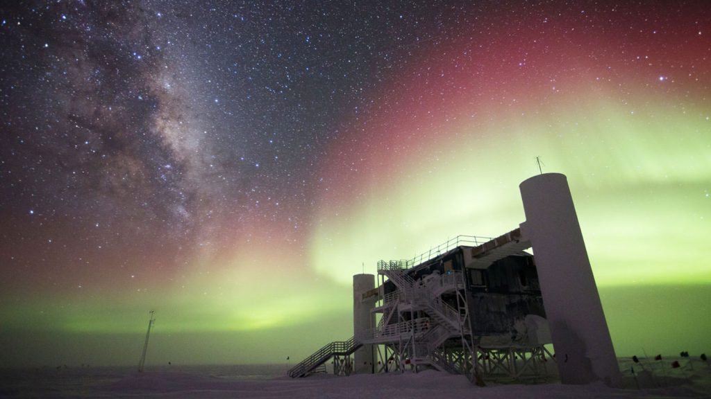 IceCube station at the South Pole amidst the southern lights